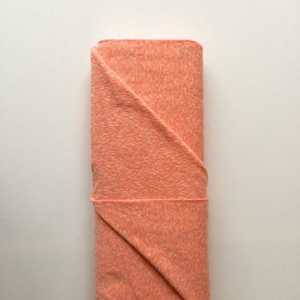 Stof zacht wollig voor vest in oranje roze zalm